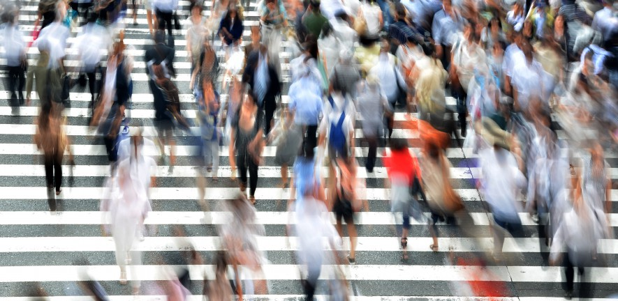 Photo of a crowd crossing a road